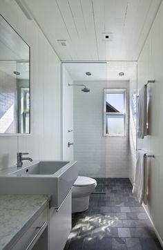 bathroom layouts Beach Style Bathroom Image Ideas Other Metro baseboards dark floors narrow bathroom rain showerhead subway tile towel bar walk-in shower white tile white wood wood ceiling wood paneling