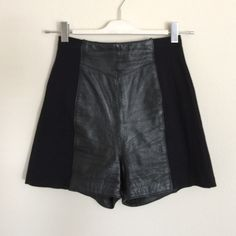 """Wilson Leather black high rise shorts 4 small Tag says medium. Fits like a small. Super cute shorts! I don't wear them enough. Great condition. 3rd photo used to show fit. Zipper back. 13"""" rise, 11.5"""" across waist. Bundle to save 25%! Wilsons Leather Shorts"""