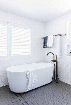 """The bathtub is a necessity if you have dogs and children, so that was the starting point for the design,"" says Darren. It was purchased from [Grays Online](http://www.graysonline.com/?utm_campaign=supplier/
