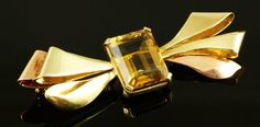 """$175  Jul 2013. 14K Rose gold, yellow gold and topaz pin, approximately 0.40 oz / 8 dwt tw, 2 1/4""""l."""
