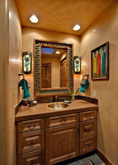 While the artwork is African, the tan suede walls, turquoise accents, and tribal patterns are perfect for a southwestern bathroom. | Stylish Western Home Decorating