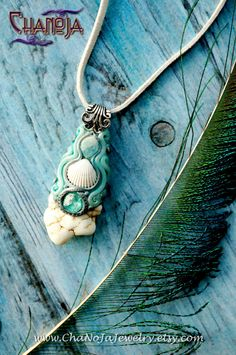 Enchanted Mermaid Pendant-magnesite shell aquamarine neon blue apatite crystal jewelry raw mineral aquamarine divine feminine ocean sea by chanoja jewelry. Creating art is my life. This piece is held in beautiful whites and aqua tones and features many beautiful items like magnesite, neon blue apatite, aquamarine and a seashell i found on the beach in spain. Mermaid Pendant, Raw Crystal Jewelry, Seashell Jewelry, Woodland Fairy, Aquamarine Gemstone, Felt Hearts, Divine Feminine, Clay Creations, Polymer Clay Jewelry