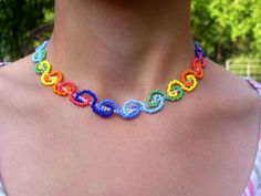 Beadsmagic.com has this Coloured Rolls necklace as well as its pattern. I thought it was pretty cool looking. Not only would it be neat with alternating shades of greens for St. Patty's Day or pinks & pearls for a highly feminine touch, but also with just pearls or pearls and rhinestones. What a lovely design!