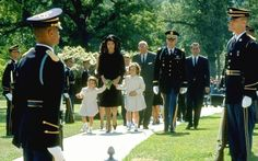 On May 29, 1964, Jackie Kennedy, accompanied by her two children, returned to Arlington National Cemetery. There she placed a sprig of lilies of the valley on President Kennedy's grave.  Many observers believe it was her way of ending the period of mourning.