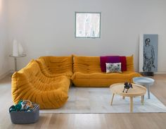 The living room is furnished simply, with a French-designed Togo sofa from Ligne Roset, as well as Danish side tables and a cowhide rug, both from Design Within Reach.