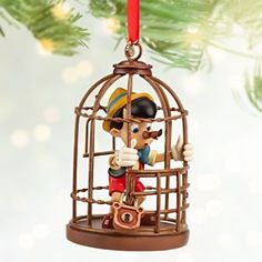 Disney Pinocchio Sketchbook Ornament | Disney StorePinocchio Sketchbook Ornament - Trapped in a hanging bird cage, Pinocchio's nose grew when he lied to the Blue Fairy about how he got there. Now our ''little woodenhead'' ornament will be hanging around your holiday tree until he learns his lesson!