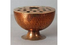 Lot 534 - A Newlyn Copper pedestal Rose Bowel with hammered finish & fitted pierced rose 'Newlyn' mark to base