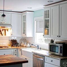 White Kitchen Cabinetry, Subway Tiles, and Wood tone