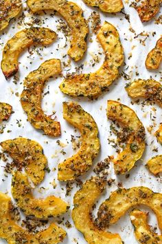 Roasted Delicata squash topped with a Parmesan-herb crust, I like to leave it in the oven until the edges are crisp, golden and delicious! Acorn squash can be used in place of Delicata.