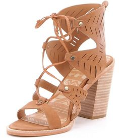 Dolce Vita Luci Women's Sandal Lace Up Stacked Heel (11, Saddle). 100% Nubuck,Heel Height: High 3 inch to 4.5 inch, Width: Medium (B, M), Occasion: Casual, Style: Sandals. Featuring add a modern, edgy vibe to your look without compromising on comfort or style with the Luci sandal by Dolce Vita. Open toe and open back design with detailed stitching,Laser-cut zig-zag design on nubuck leather upper. Ghillie inspired front lace-up closure with studded accents,Cushioned leather and man-made...