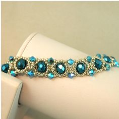 Turquoise and Silver Swarovski Crystal Bracelet This bracelet has been handwoven using 6mm pearl coated fire polished beads in deep turquoise and accented with Swarovski bicones in turquoise ABX2.