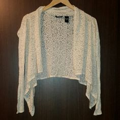 NWOT Drapey Lace cardigan Cream color lace cardigan that drapes in front. Like new, never worn. Moda International Tops Sweatshirts & Hoodies