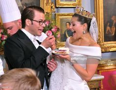 Crown Princess Victoria of Sweden and Prince Daniel, Duke of Vastergotland share a slice of wedding cake during the Wedding Banquet at the Royal Palace on June 19, 2010 in Stockholm, Sweden.