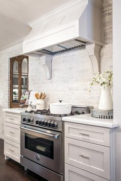 "LOVE the white brick backsplash Fixer Upper: Midcentury ""Asian Ranch"" Goes French Country Kitchen Ikea, White Kitchen Backsplash, New Kitchen, Kitchen Decor, Backsplash Design, Kitchen Cabinets, Backsplash Ideas, Whitewash Brick Backsplash, Shaker Cabinets"