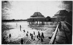 Damage to Galveston, Texas during the 1900 Storm. Galvestonians enjoyed the beach and surf at The Pagoda, described as 'a building extending out into the sea on a piling, with a long walk.' Islanders watched the sea from the walkway for the last time on September 8, 1900 when a hurricane of 100-plus miles per hour and towering tidal waves destroyed or damaged  most of the city, killing thousands.  The Pagoda was not rebuilt. HOUCHRON CAPTION (09/03/2000): Bathers enjoy the surf of the…