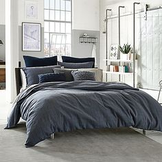 Give your bed a relaxed, casual look with the cozy Kenneth Cole Reaction Home Douglas Reversible Duvet Cover. Decked out in a dark blue plaid with a pop of electric blue, the handsome bedding instantly creates a lived-in look in any bedroom.