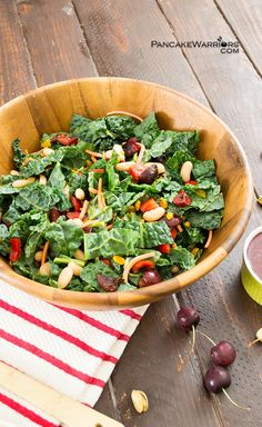 Try this anything but ordinary kale salad for dinner tonight! Homemade cherry balsamic dressing, salty pistachios, creamy cannellini beans and fresh dark sweet cherries. Vegan, gluten free and easy to make. 10 minute meal! | www. pancakewarrios.com