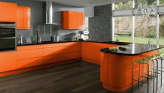 Cool Orange Kitchen Cabinets with Gray Backsplash and Black Countertop in U-Shape Kitchen Design Furnished with Bar Kitchen Stools and Completed with Mosaic Wall Decor Ideas