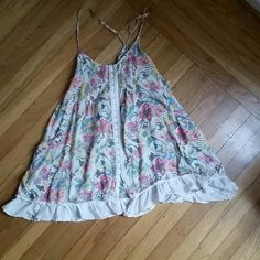 Free People Beautiful Swing Top Gorgeous and rare, swing summer floral FP blouse, racer back, adjustable straps has two pockets, Excellent and Perfect Condition TRADE VALUE 120 Free People Tops