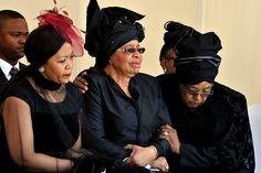 Graca Machel (c), widow of former South African President Nelson Mandela, sheds a tear as Winnie Mandela (r.), ex-wife of Mandela, comforts ...