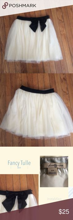 "Flirty Tulle Skirt This is no ordinary Tulle Skirt, it has a Satin lining, 3 Layers of Tulle, a hidden side zipper, a Satin waistband and a Satin Bow. You will adore this skirt. Measurements: Waist: 26"", Hips: 34"", Length: 17 1/2"". TwentyOne Skirts Circle & Skater"