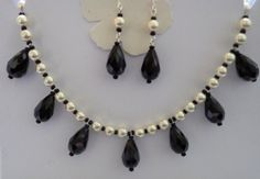 Glass Pearl and Black tear drop necklace and matching earrings