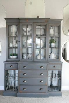 A dark grey (gray tabby) painted hutch with white ironstone, wire baskets and grain sack stripe painted interior. Painted China Cabinets, Decor, Furniture, Furniture Makeover, Furniture Projects, Painted Furniture, Furniture Inspiration, Redo Furniture, Refinishing Furniture