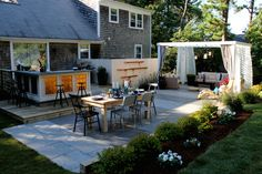 """More outdoor space means more chances to entertain in warm weather — and less work for you. """"Creating outdoor living spaces lends itself to low-maintenance landscaping because you can extend your home while having fewer grassy areas to care for,"""" says Peyton. The couple has a stone patio with a grilling area, dining table, and separate fire pit area in their home. Similarly, a deck is an equally low-maintenance option. From ELLE DECOR"""