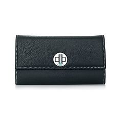 City clutch wallet in onyx grain leather. More colors available.