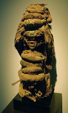 (Alain de Monbrison)  A haunting looking Congo Fetish (Songye/ Kusu?) laden with fetish bundles