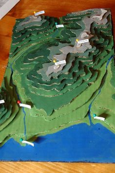 Make a cardboard model of your area using local topography maps (from Nurtured By Geography Activities, Geography For Kids, Maps For Kids, Teaching Geography, World Geography, Teaching Science, Map Projects, School Projects, Projects For Kids