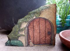'*The Witch's Door* - Hand Painted Rock Art' is going up for auction at 2pm Mon, Aug 5 with a starting bid of $9.