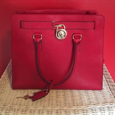 MICHAEL KORS structured red bag. MICHAEL KORS structured red bag. Can be an arm bag or shoulder bag. Has four inside pockets and a zipper pocket. Used for a few months. In great condition. Michael Kors Bags Totes