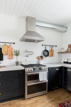 Blogger Ashley of Cherished Bliss uses sleek, modern appliances and black inset cabinetry to create her rustic modern kitchen.
