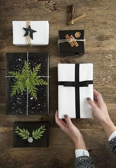 Black and white Christmas gift wrapping with fresh green details