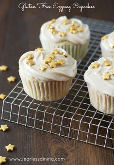Gluten Free Eggnog Cupcakes on a cooling rack. There are gold star sprinkles on top of the cupcakes.