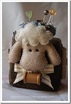 This is the cutest pin cushion ever!.  The link goes to a non-English site.