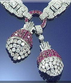 Circa 1935 necklace suspending a pair of ruby and diamond drops set with brilliant-cut diamonds and circular-cut rubies and accented with baguette diamonds, to a similarly set diamond necklace of openwork plaque design, with Brazilian link back chain.