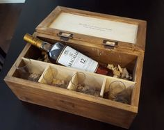 This is a Scotch or Whiskey gift box set that was built to hold two 6 oz Glencairn glasses. Its made with a separation for the bottle and includes a bed of fine wood shavings to cradle the bottle. The other side of the partition has room for 2 glasses (not included).  Its made of reclaimed pallet wood. It also has beautiful rubbed bronze knife hinges.  This one was made specifically for a Macallan 12 year bottle, but I can make them to any bottle size. just provide the brand. Or I can make…