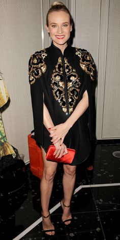03/19/12: Always ahead of the curve, #DianeKruger looked stylish in an ultra-chic cape!