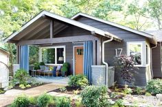 Preserving the style of a charming bungalow, this home offers a modern twist with bold colors and a stylish front porch. From the experts at HGTV.com.
