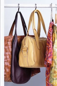Organize and store handbags with shower hooks - I'm so doing this!