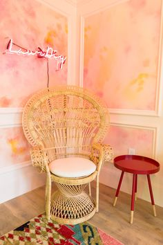 A feminine, bohemian, colorful seating area in a corner of a home office!