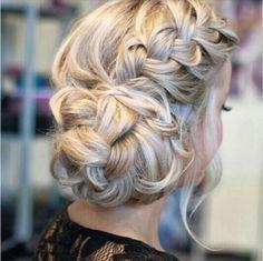 Beautiful low curl bun with side braid.