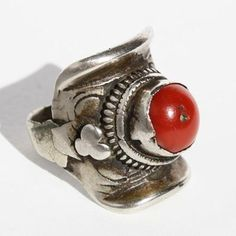 Tibetan Ring,  Tibet.  A very old, well-worn, silver saddle ring with a rich red coral