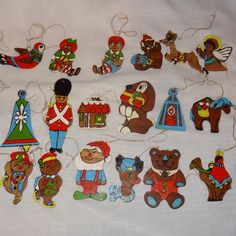 Different themes. Toy Soldier, drum, angels, lantern, Raggedy Ann and Andy, Teddy Bear, Tree, Rocking horse, plus more. 24 different ornaments. Condition: Two ornaments are missing their strings. Paint wear, stains, dirt and smudges on several of the ornaments. | eBay!