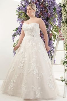 """For brides who carry most of their weight on the front of their torsos, a ball gown that nips in at the natural waist is a great option, such as this Callista style. It narrows the smallest part of the body while simultaneously disguising anything beneath the waist."""