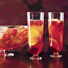 Put 2 fingers' high of Amaretto (about 1/8 of a tall glass), add a twist of lemon juice and the juice of half an orange. Mix and refrigerate. Before serving add some Prosecco (or champagne), and top with a bit of soda. Garnish with oranges, lemons and raspberries.
