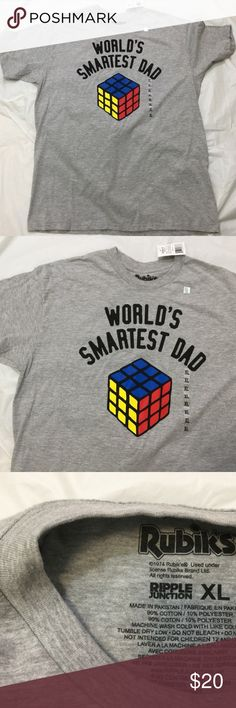 Rubiks Cube Mens Tshirt XL Dad This is a great gift for dad. Mens short sleeve tee size XL  WORLDS SMARTEST DAD written on the front with a picture of a rubiks cube  The teeshirt is gray   It measures approx. 22 inches across the chest laying flat  It is 31 inches long  Please ask any questions that you may have Rubiks Shirts Tees - Short Sleeve