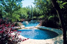 Pool with water feature -- Curated by: Aqua Trends Pool & Spa | #103, 1990 Cooper Rd. Kelowna BC V1Y 8K5 | 250-868-1960